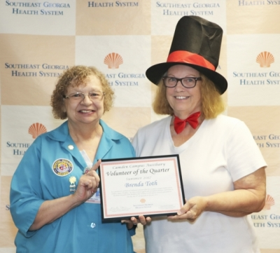 Brenda Toth Receiving Volunteer of the Quarter
